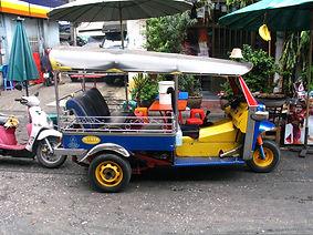 Thai Tuk Tuk taxi parked on a Bangkok street