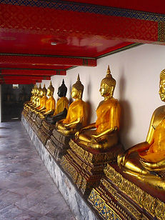 A line of golden buddha's in Wat Pho, Thailand