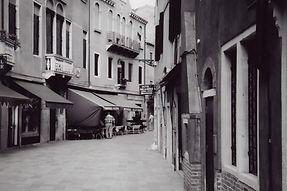 A scene outside on a Venetian street outside the Hotel El Sol