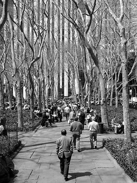 Black and White pick of man walking through Bryant Park in New York City