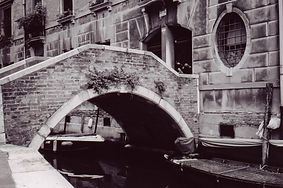 Black and White Film shot of Canal Bridge in Venice, Italy