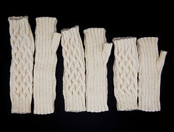 Knit white patterned fingerless gloves in small, medium, and large sizes