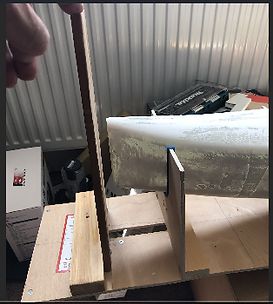 End plate on jig to check bow is vertica
