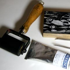 Wood block, roller, ink and woodblock tools