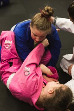 Girls training Brazilian Jiu Jitsu