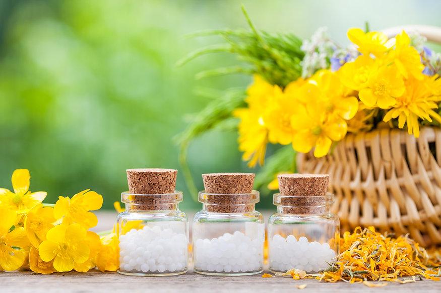 Bottles of homeopathy globules and healt