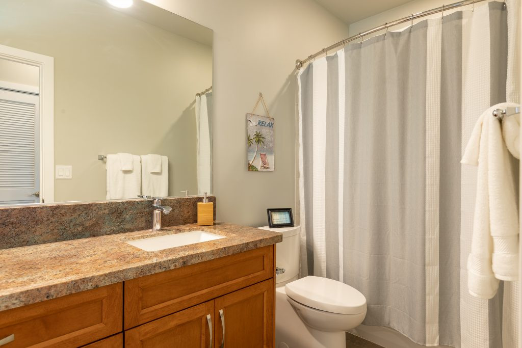 Third full bathroom located on the North side of house and shared by bedroom 3 and4
