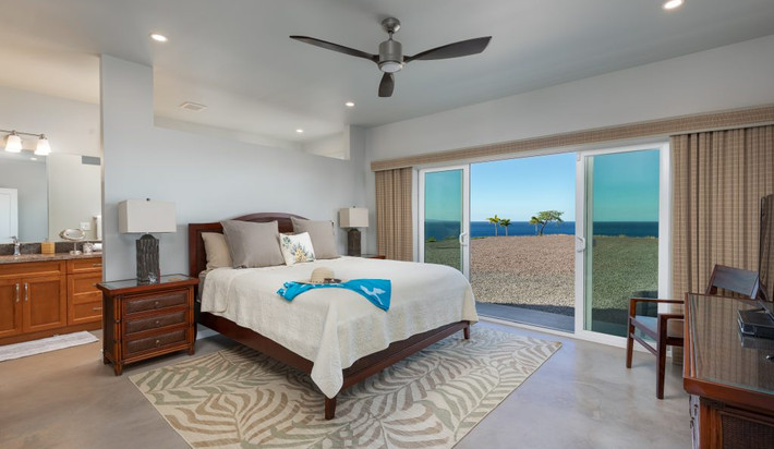 South Master bedroom with ocean views, attached bathroom and access to the pool