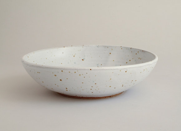 Serving bowl with speckled white glaze and copper green splash