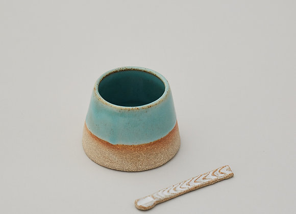 Green condiment pot with spoon