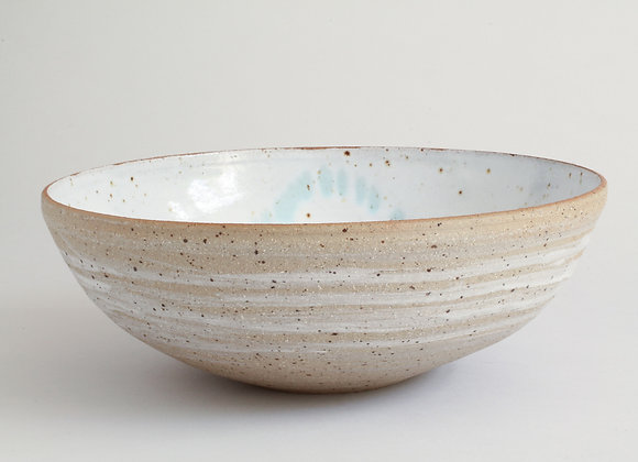 Serving bowl with white speckled glaze & copper green spashes