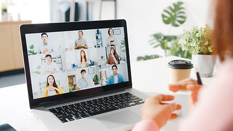 young-asia-businesswoman-using-laptop-talk-colleague-about-plan-video-call-meeting-while-w