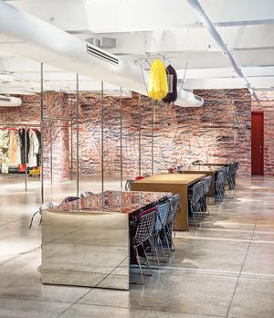 Custom stainless steel and wood retail visual display Calvin Klein showroom