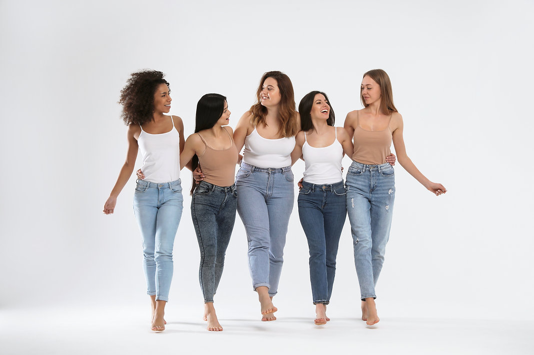 Group of women with different body types on light background.jpg