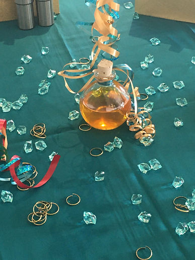 Add curled ribbon and some bling to the table to correspond withthe theme!
