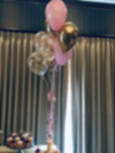 The combination of stenciled, solid and chrome balloons makes a stunning balloon centerpiece!