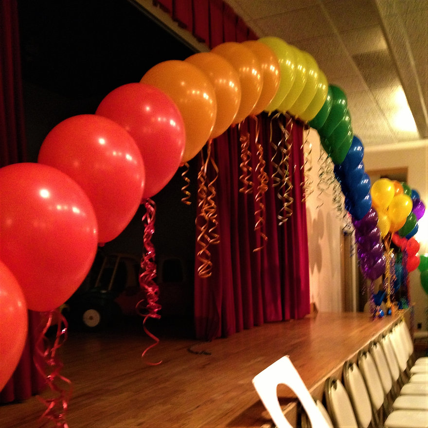 A rainbow string of pearl  balloon arch!