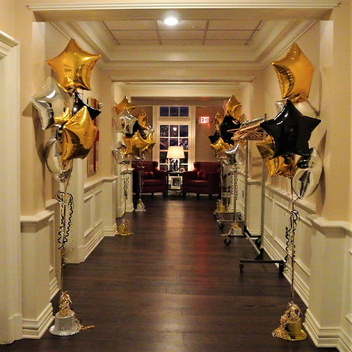 The entrance hallway balloon trees help create the mood for a broadway themed Sweet 16!