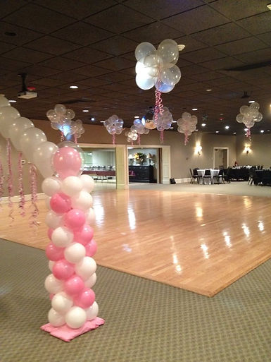 Combination of a string of pearl arch with columns and balloon clouds over the dance floor!