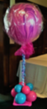 A giant lollipop was created using a three foot agate balloon for this sweet sixteen event!