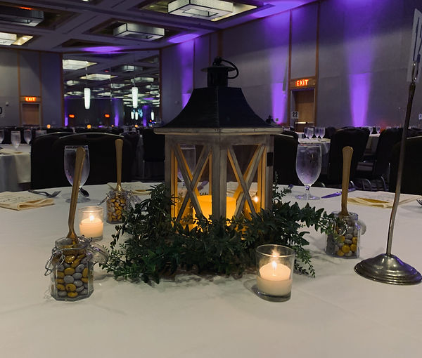 Place folliage at the base of a table lantern and add a candle.  Stunning!