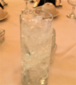 "Change up a weight!  Here is an ""ice filled"" vase for a hockey themed Bar Mitzvah!"