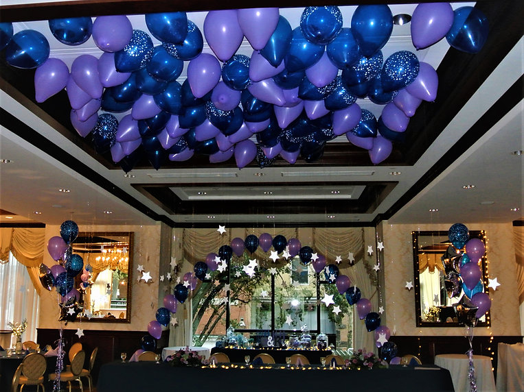 Adding balloons over a dance floor creates more excitement to the room!