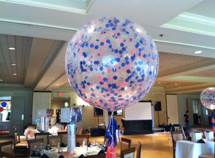 We placed paper confetti inside these clear three foot balloons for this B'nai Mitzvah!