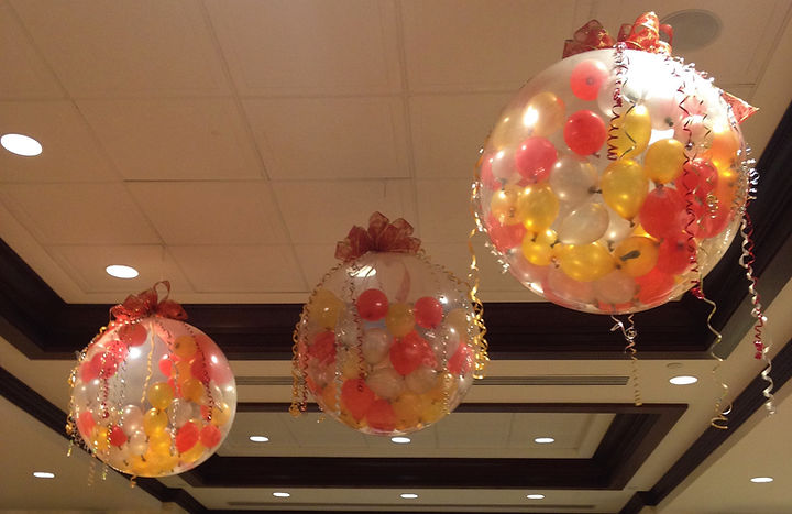 Three foot balloons stuffed with sixty five inch balloons!