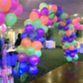 Use lots of colors to create vibrancy in any balloon arch!
