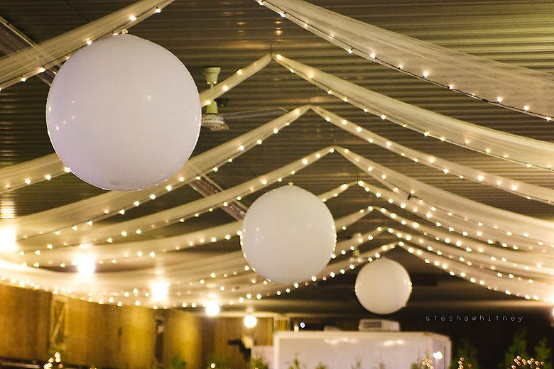 Three foot balloons were hung from the ceiling for this rustic barn wedding!