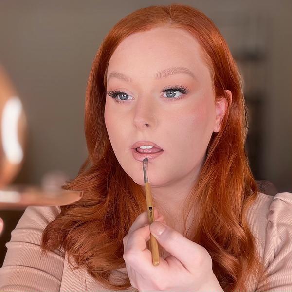Luxury lipstick application. charlotte tilbury nude kate