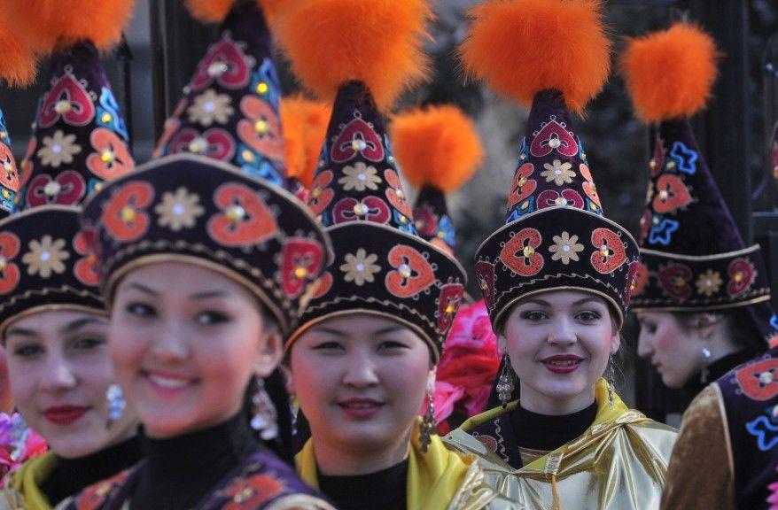 Kyrgyz women wearing Takiya during Norwuz in Kyrgyzstan