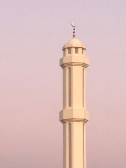 Minaret over the dusty sky