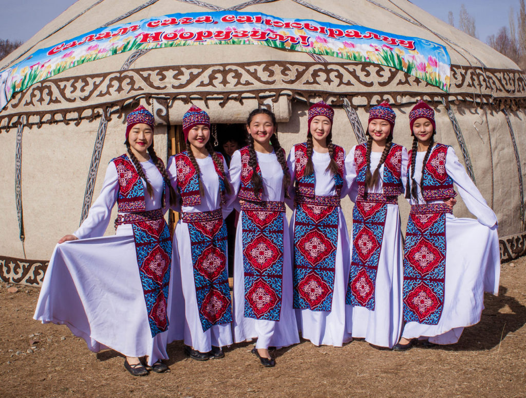 Women celebrating Nowruz in Kurgyzstan wearing the traditional Shokulo, a conincal hat.
