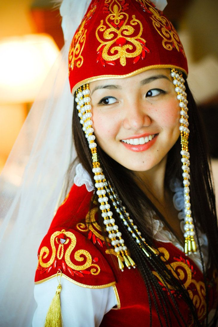 A beautiful Kyrgyz woman wearing traditional kyrgyz costume akin to a wedding outfit