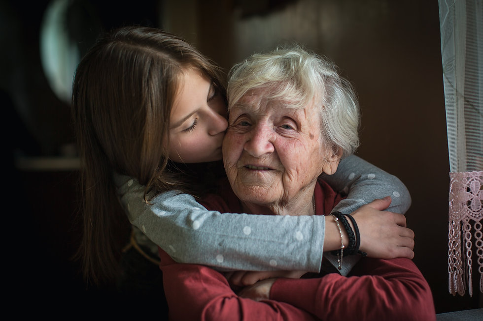 A little girl hugs her grandmother..jpg
