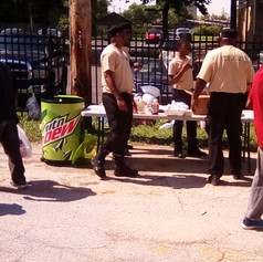 BFL's Outreach Team goes into high action at Ground Zero (Aubert & Suburban Tracks, St. Louis MO, distributing food, clothing -- and HUGS -- on Wednesday, Friends of Fountain Park's first effort!