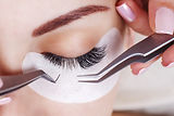 Eyelash Extension Procedure. Woman Eye w