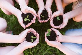 kids-holding-their-hands-clover.jpg