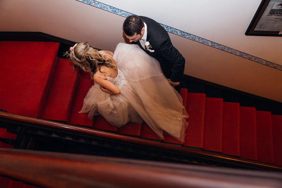 Groom escourting his wife up stairs