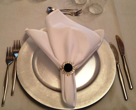 Silver charger plate for table decoration.