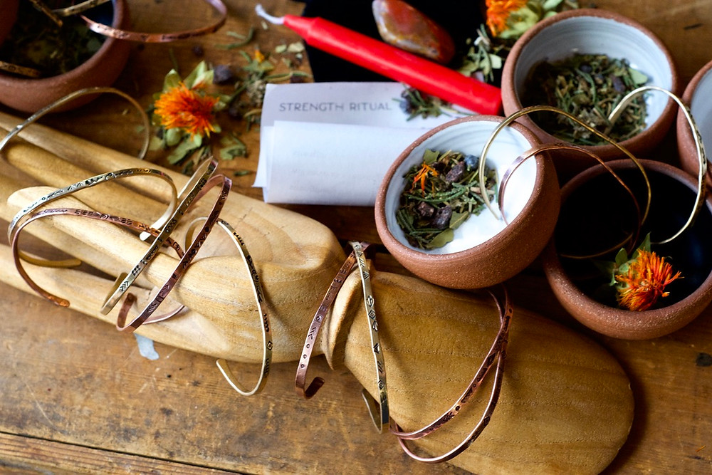 Elemental Essentials box by Christina Holland Designs. Handcrafted bangle braclets, strength ritual from the Ninth House, ceramic bowls by StoneWareWolf. Photo by Weston Holland Photography