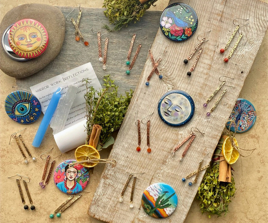 jewelry by Christina Holland Designs. Ritual kit by the Ninth House Shop. Pocket mirrors with artwork by Creative Kismet.