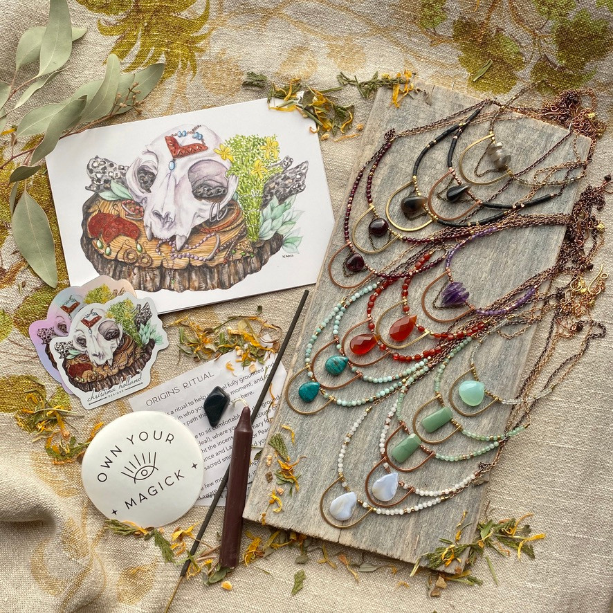 Essentials Elements subscription box for October: Origins. Handcrafted jewelry by Christina Holland Designs. Origins grounding ritual by the Ninth House. Bobcat skull artwork by Nathalie Aall of Aall Forms of Life, custom made for Christina Holland Designs.