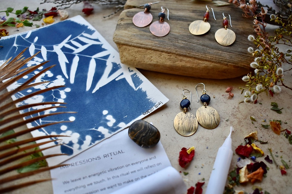 Brass Elements & Copper Creations earrings by Christina Holland Designs. Cyanotype prints by Chelsea Whitaker Photography. Impressions Ritual from The Ninth House. Photography by Weston Holland Photography.