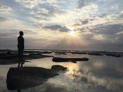Nelisiwe overlooking the ocean