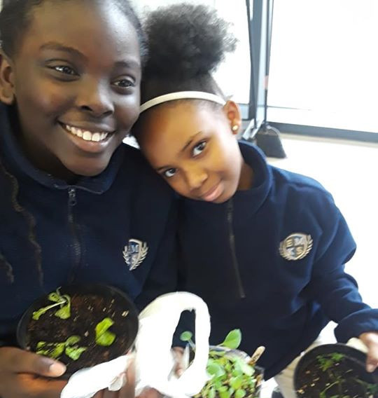 STUDENTS ENJOYING TAKING THEIR PLANTS HO