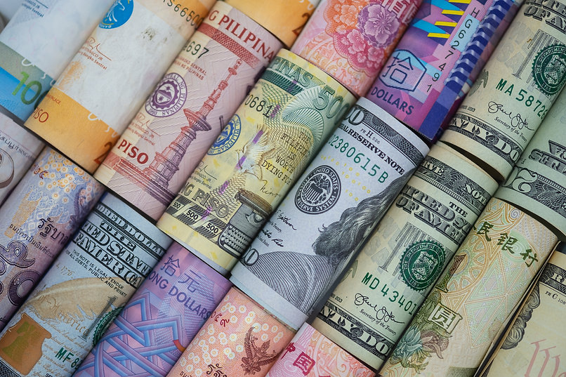Closeup rolled of variety banknote aroun