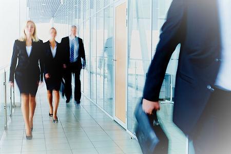bigstock-Business-people-walking-along--